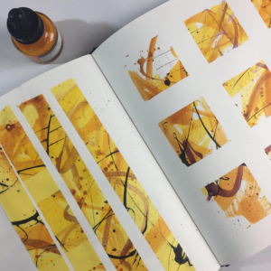 Art table notes on sketchbook. Yellow and orange sketchbook painting by Kore Sage