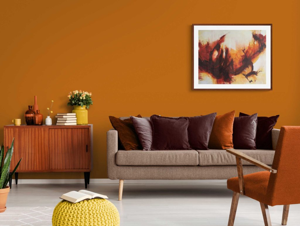 Original abstract red seascape painting by Kore Sage on burnt orange living room wall